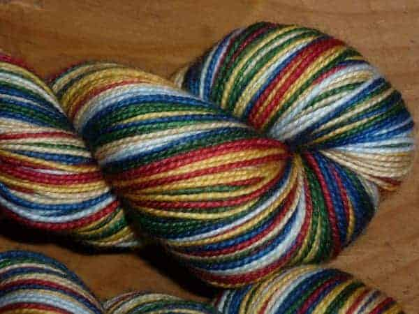 This Rushmore-inspired skein has 3-4 rows each of navy, oxford blue, khaki, red beret, mustard and green velvet.