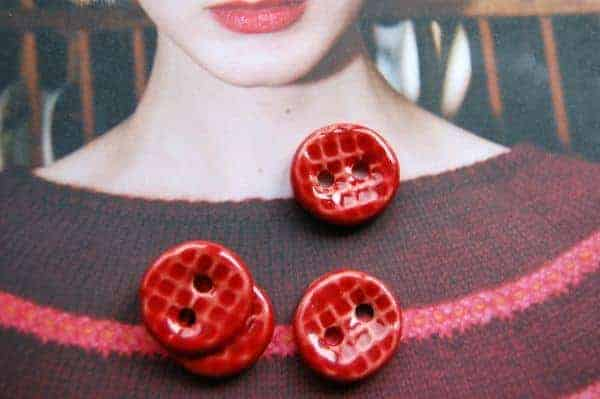 Just one set of buttons Sharry sent along for the Rhinebeck Trunk Show, appropriately displayed on a copy of the UK-based Pom Pom Quarterly.