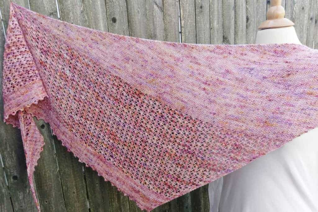 A pink speckled lace shawl.