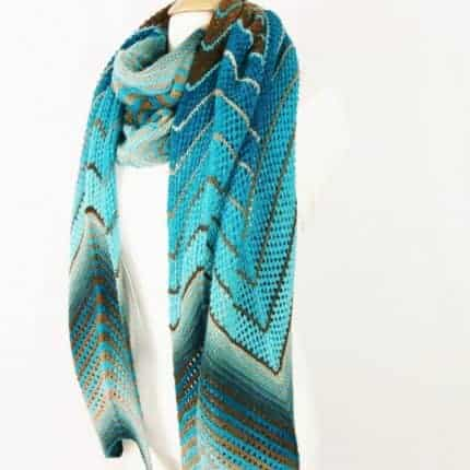 A geometric shawl in a teal to aqua gradient.