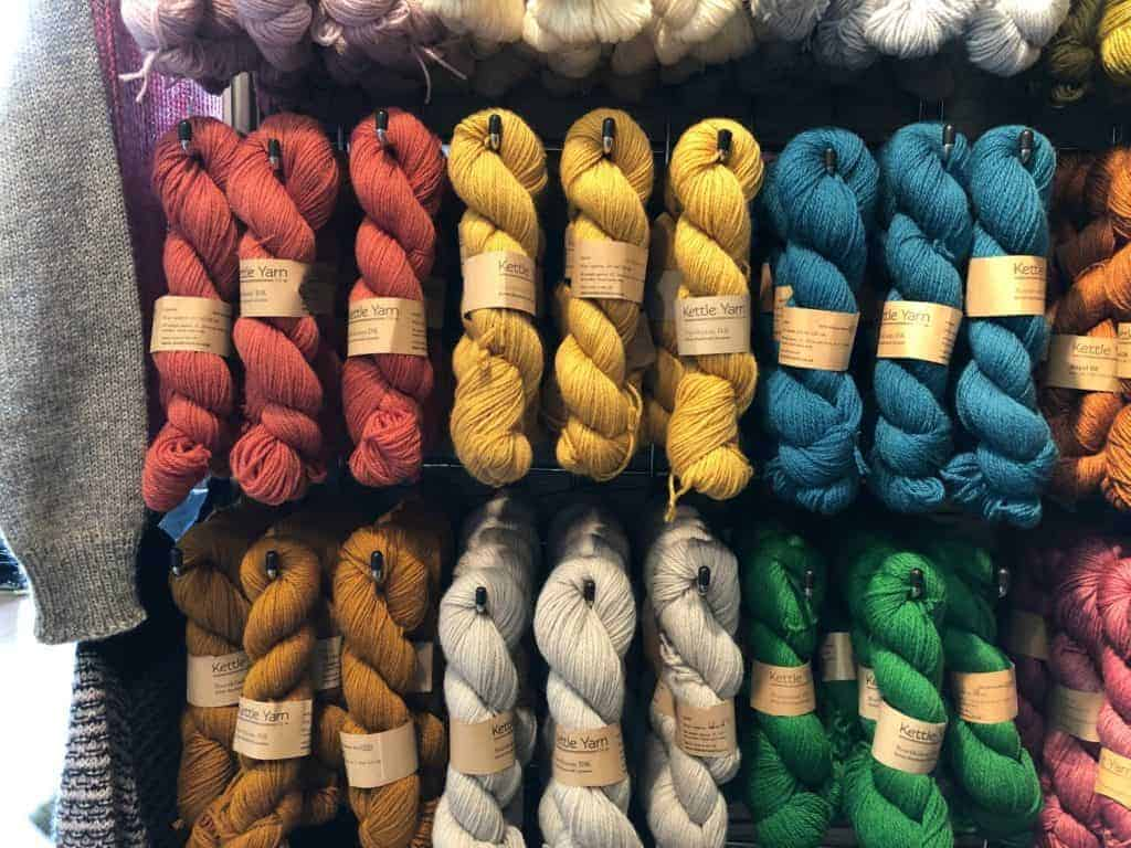A wall of colorful yarn.