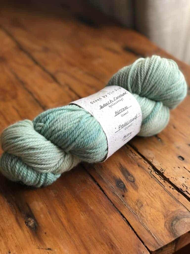 A skein of light aqua yarn.