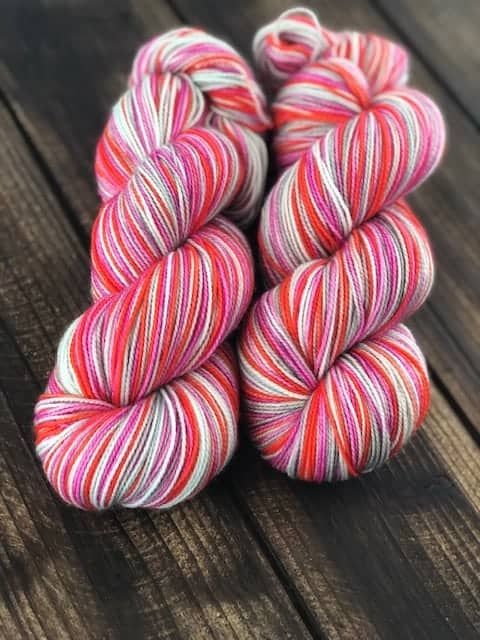Yarn with red, white and purple stripes.