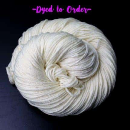 A white skein of yarn in a spiral with the words Dye To Order above it.