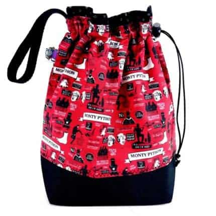 A drawstring bag with red Monty Python-themed fabric.