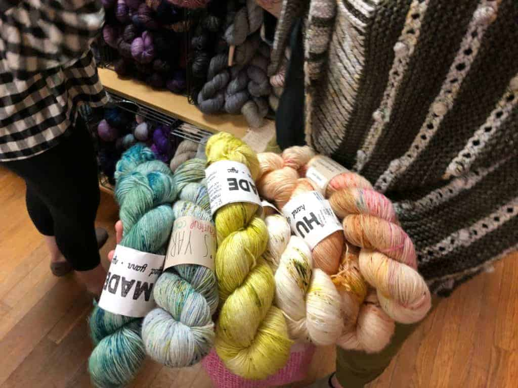 Showing off colorful skeins of yarn.