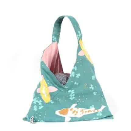 A bag with aqua fish fabric.