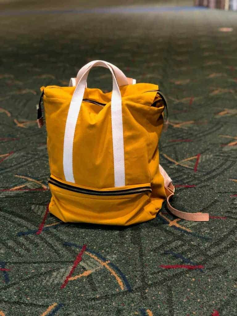 A yellow canvas backpack.