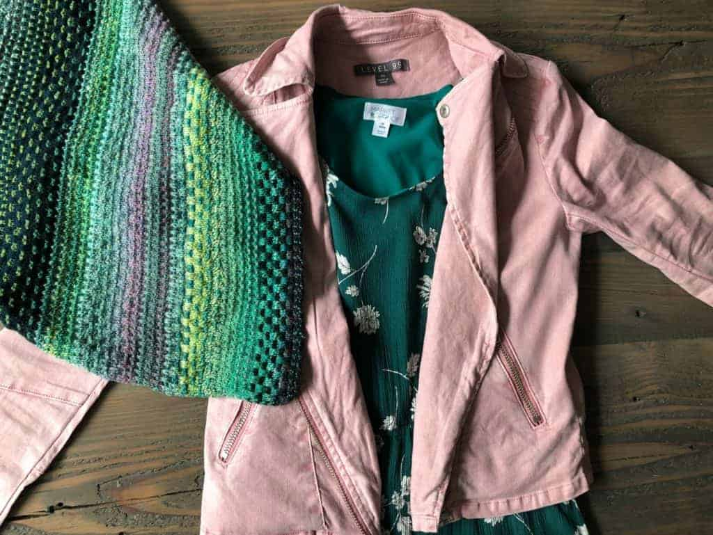 A green floral dress with a pink moto jacket and a green cowl.