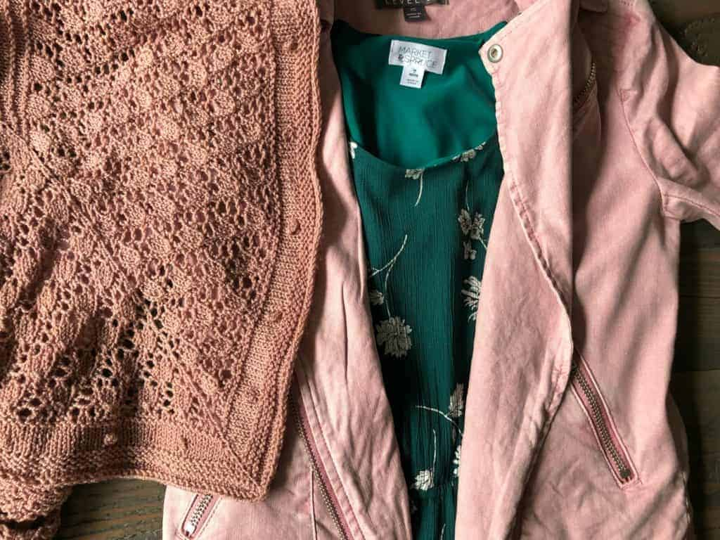 A green floral dress with a pink moto jacket and a blush pink lace shawl.