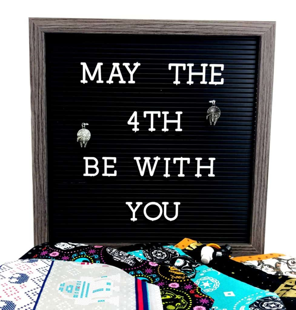 A May the 4th Be With You letter board with Star Wars accessories