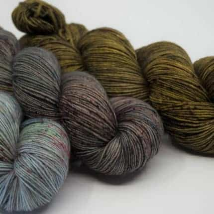 A trio of blue, grey and olive green single-ply yarn.
