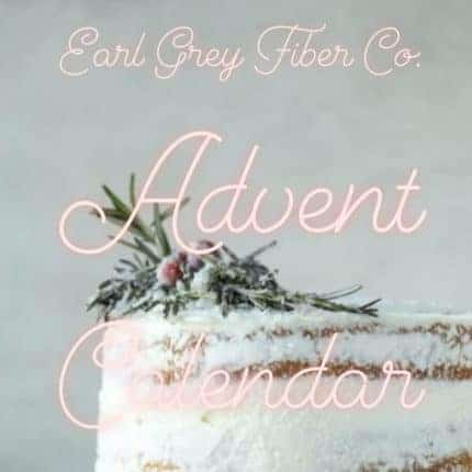 A frosted cake decorated with a sprig of holly, with the words Earl Grey Fiber Co. Advent Calendar.