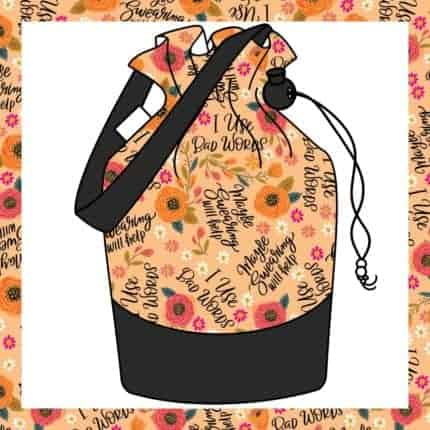 An orange floral bag with I love bad words.