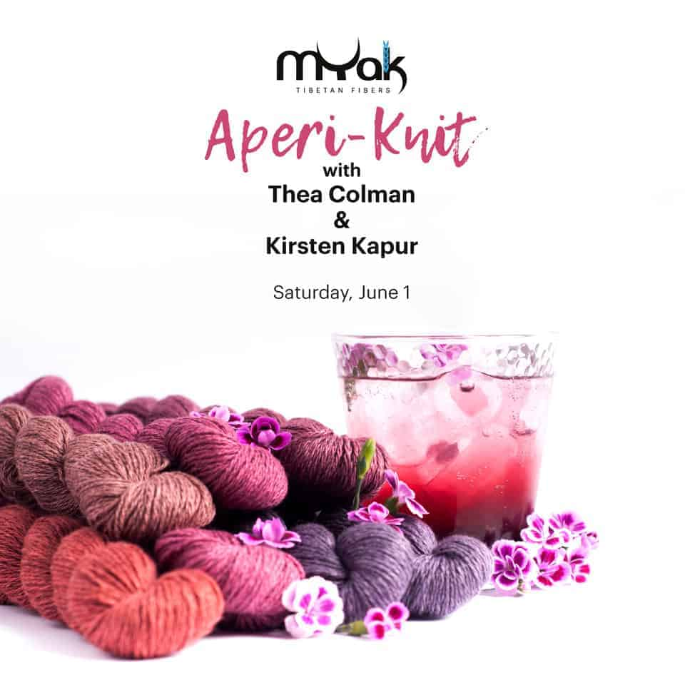 A pink cocktail surrounded by skeins of pink and purple yarn.