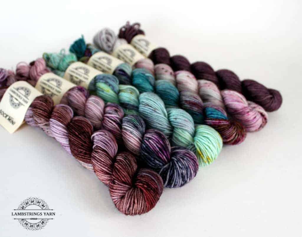 A set of purple, pink and aqua variegated mini skeins.