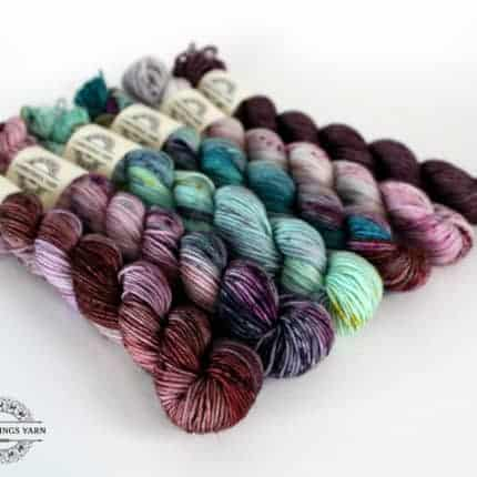 A set of purple, pink and aqua variegated mini skeins.