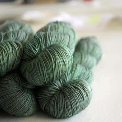 Spruce green semisolid yarn.