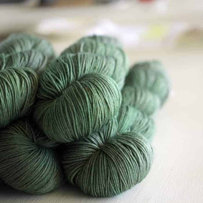Spruce green semisolid yarn.