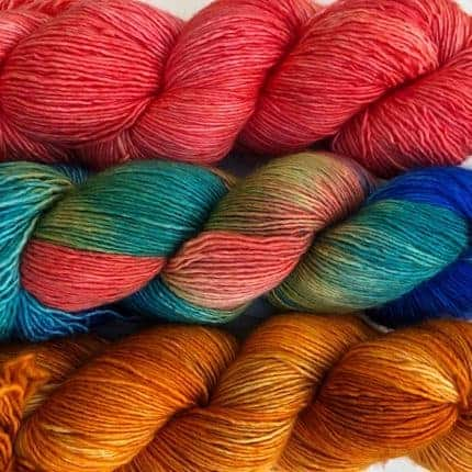 Coral, variegated and gold yarn.