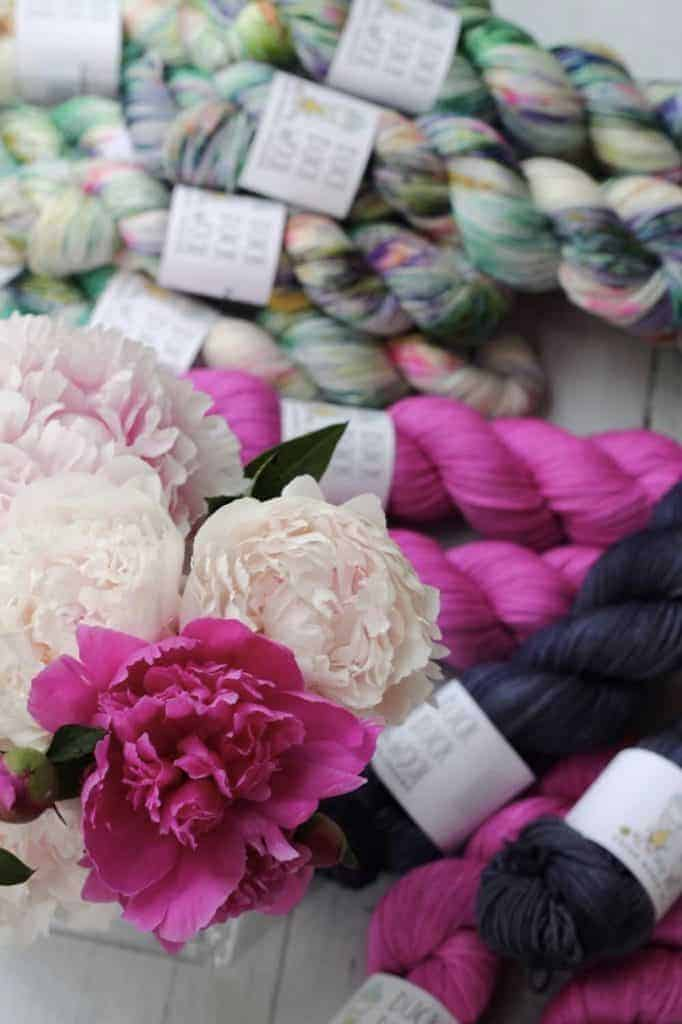 Dark blue, bright pink and speckled yarn with pink peonies.