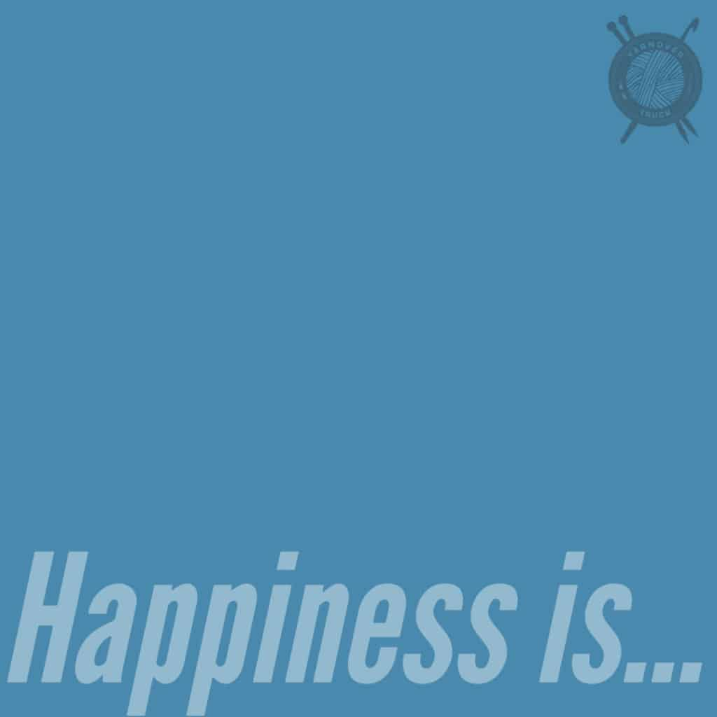 A teal square with the words Happiness is...
