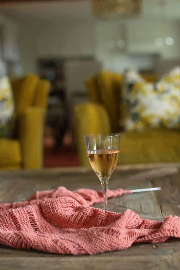 A pink shawl and a glass of rosé wine.