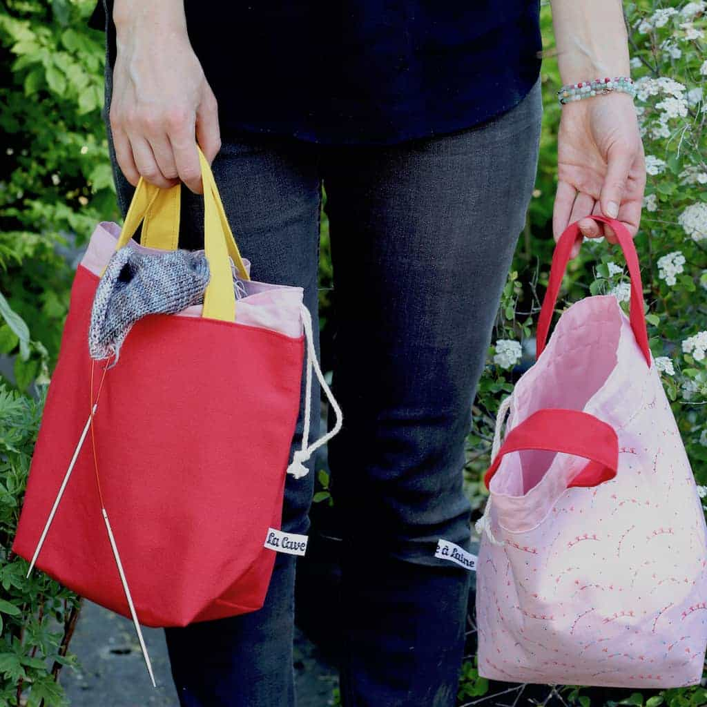 Red and pink project bags for knitting.