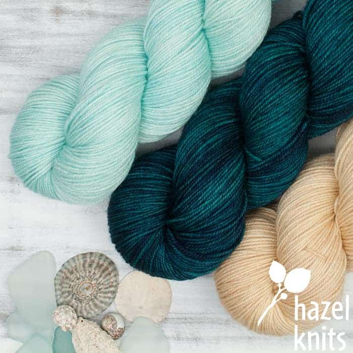 Aqua, teal and sand-colored yarn.