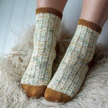 Cream speckled and gold socks.