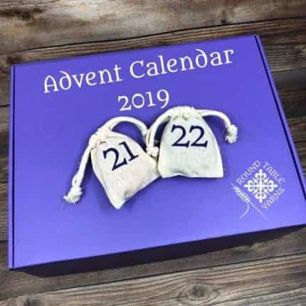 A purple box with two muslin bags with the numbers 21 and 22 and the words Advent Calendar 2019