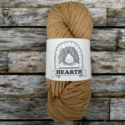 A skein of beige yarn.