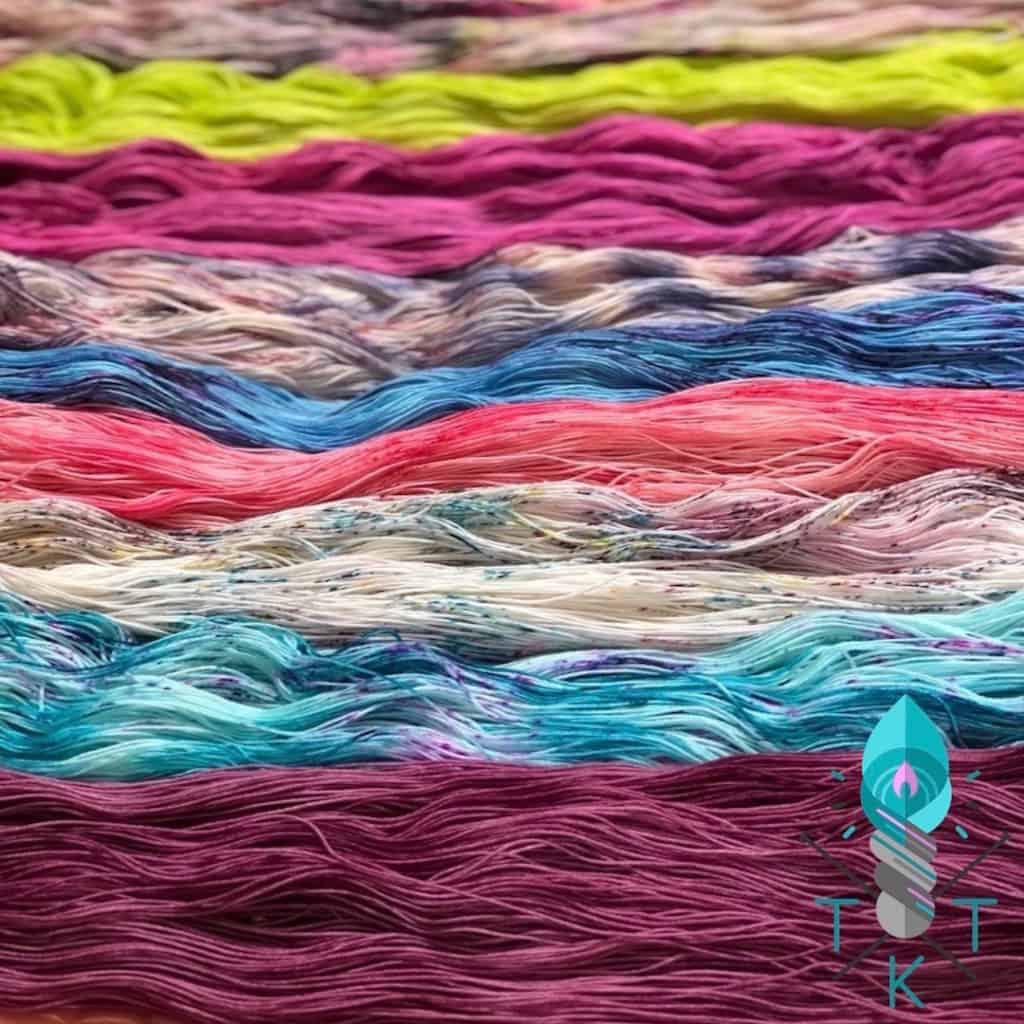Untwisted hanks of colorful yarn.