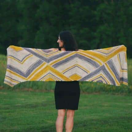 A rectangular wrap with cream, blue and yellow stripes