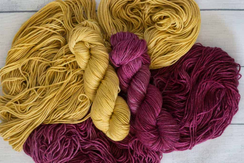 Yellow and berry colored yarn