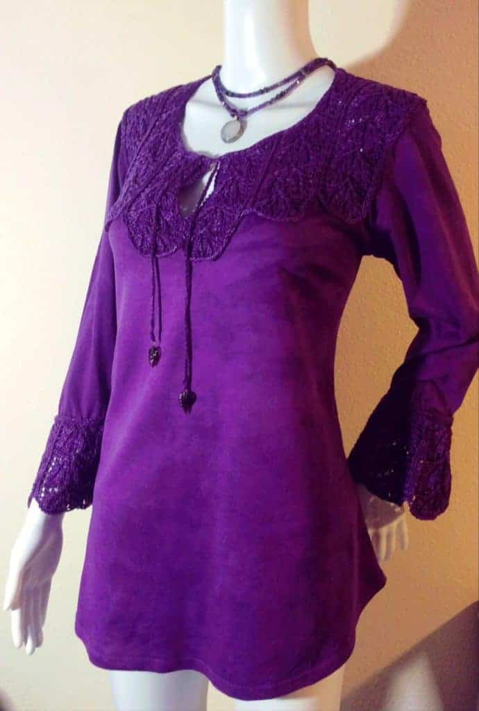 A baggy purple long-sleeve T-shirt with a purple lace trim