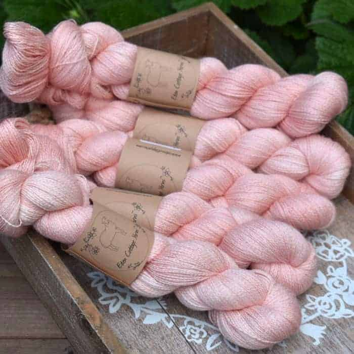 Skeins of pale pink yarn