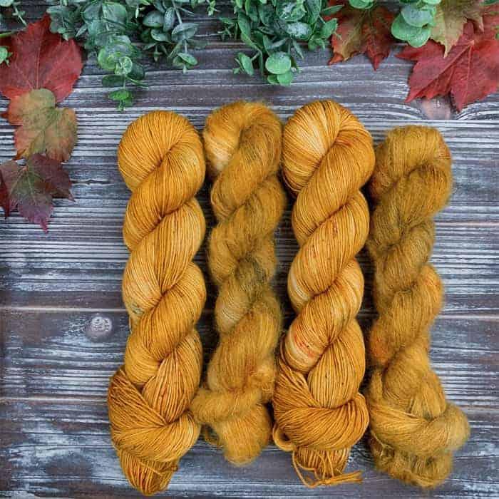 Four golden skeins of yarn