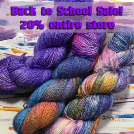Skeins of solid purple and blue and orange and pink, blue and yellow variegated yuarn with the words Back to school sale, 20% off entire store