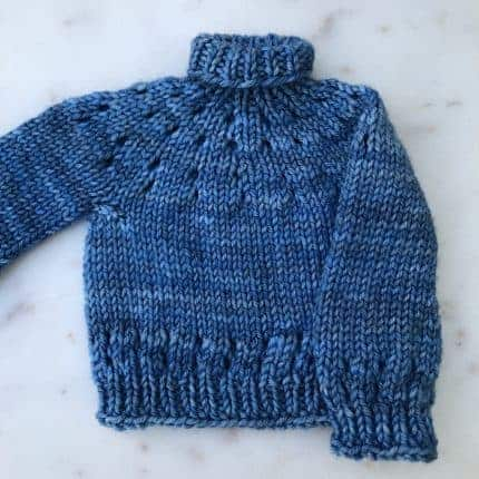 A blue mini turtleneck sweater