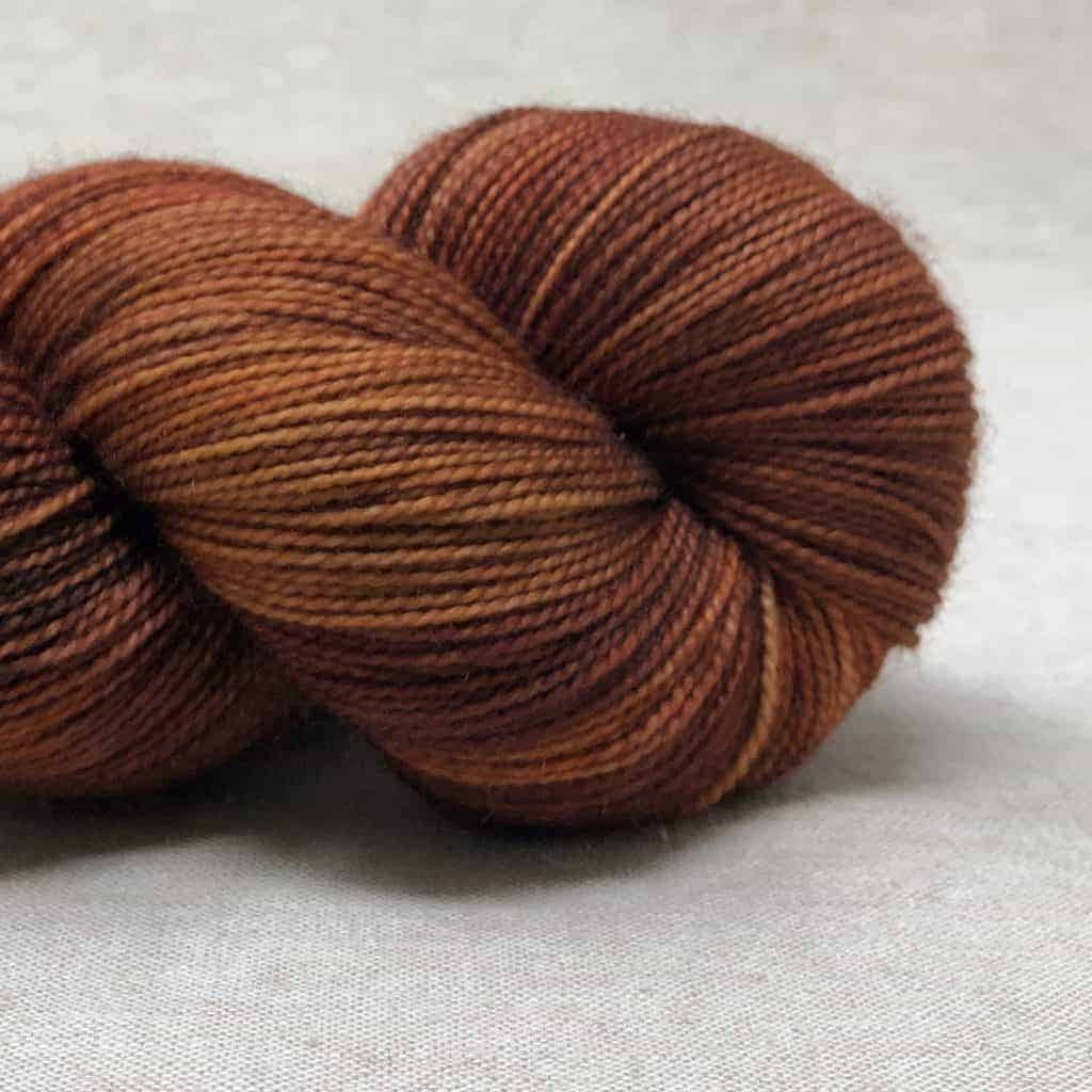 A skein of orange red yarn