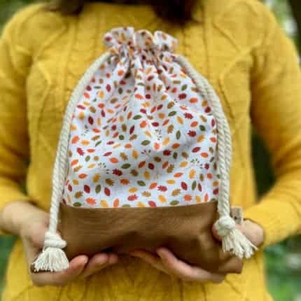 A drawstring bag with fall leaf fabric
