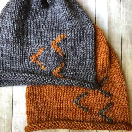 A gray hat with an orange accent and an orange hat with a gray accent