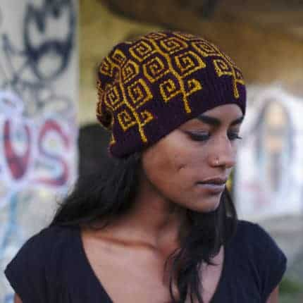 A maroon hat with a yellow geometric pattern