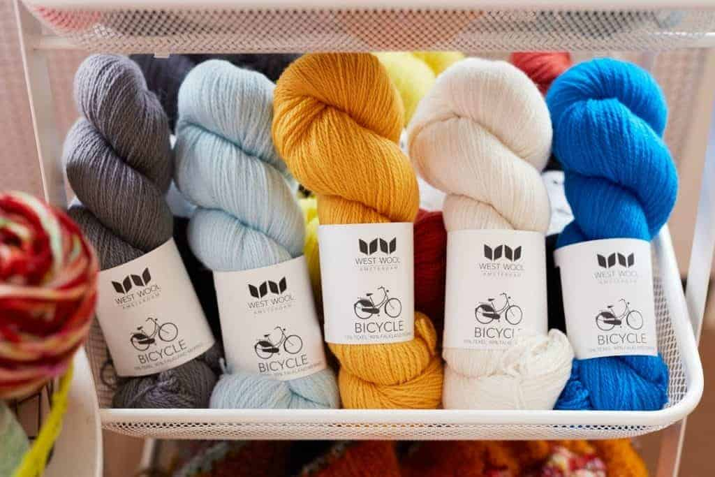 West Wool Bicycle yarn in grey, light blue, gold, light pink and bright blue.