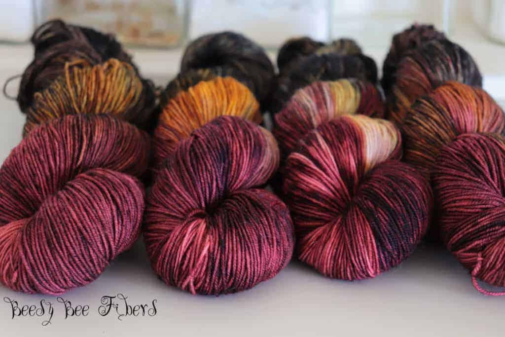 Skeins of plum and orange variegated yarn