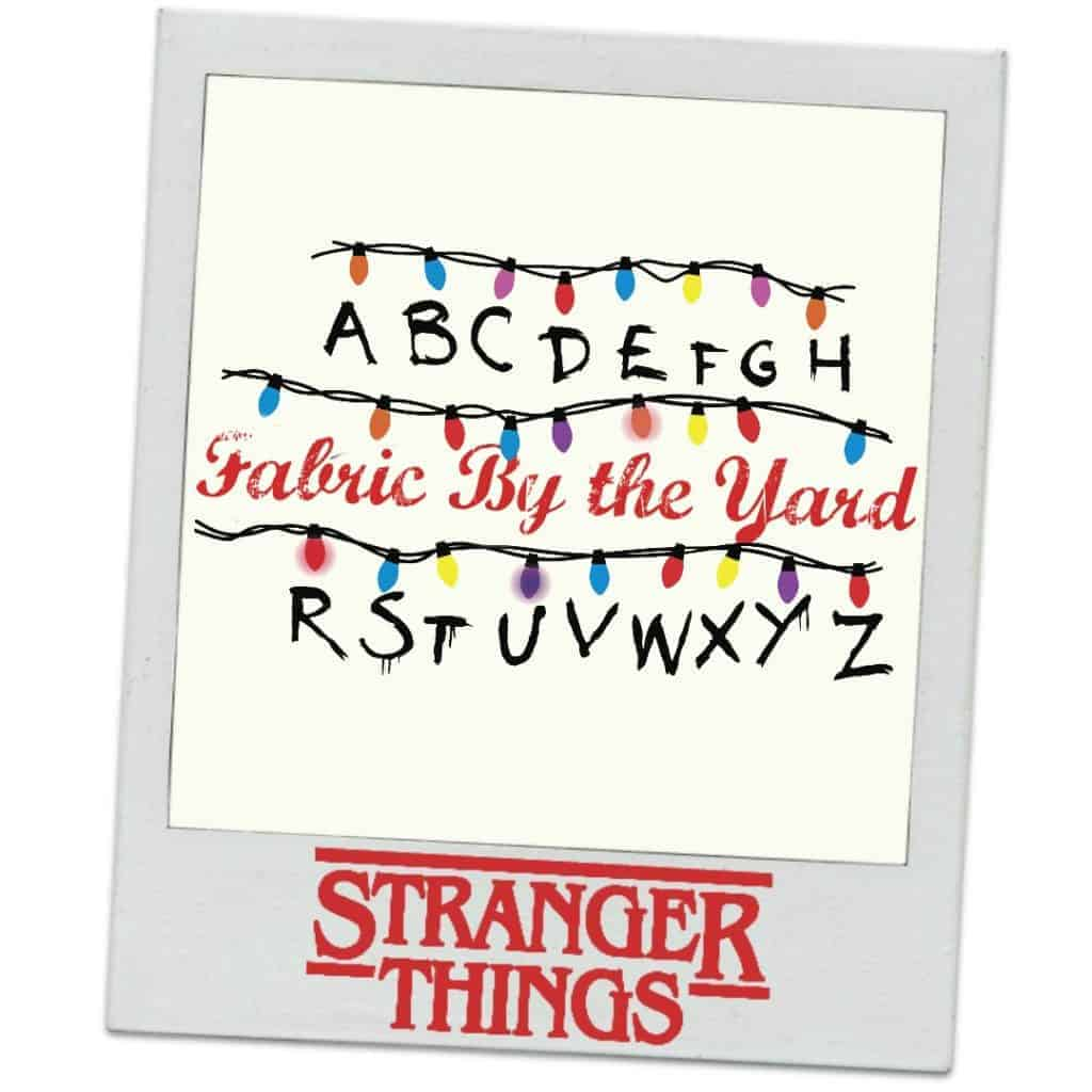 Christmas lights and the alphabet and the words Fabric by the yard and the Stranger Things logo