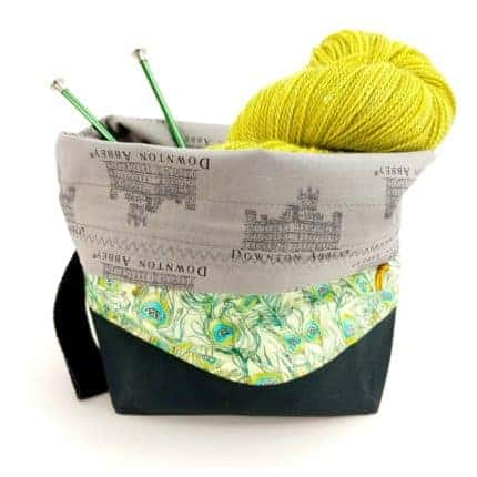 A green floral bag with a gray Downton Abbey lining