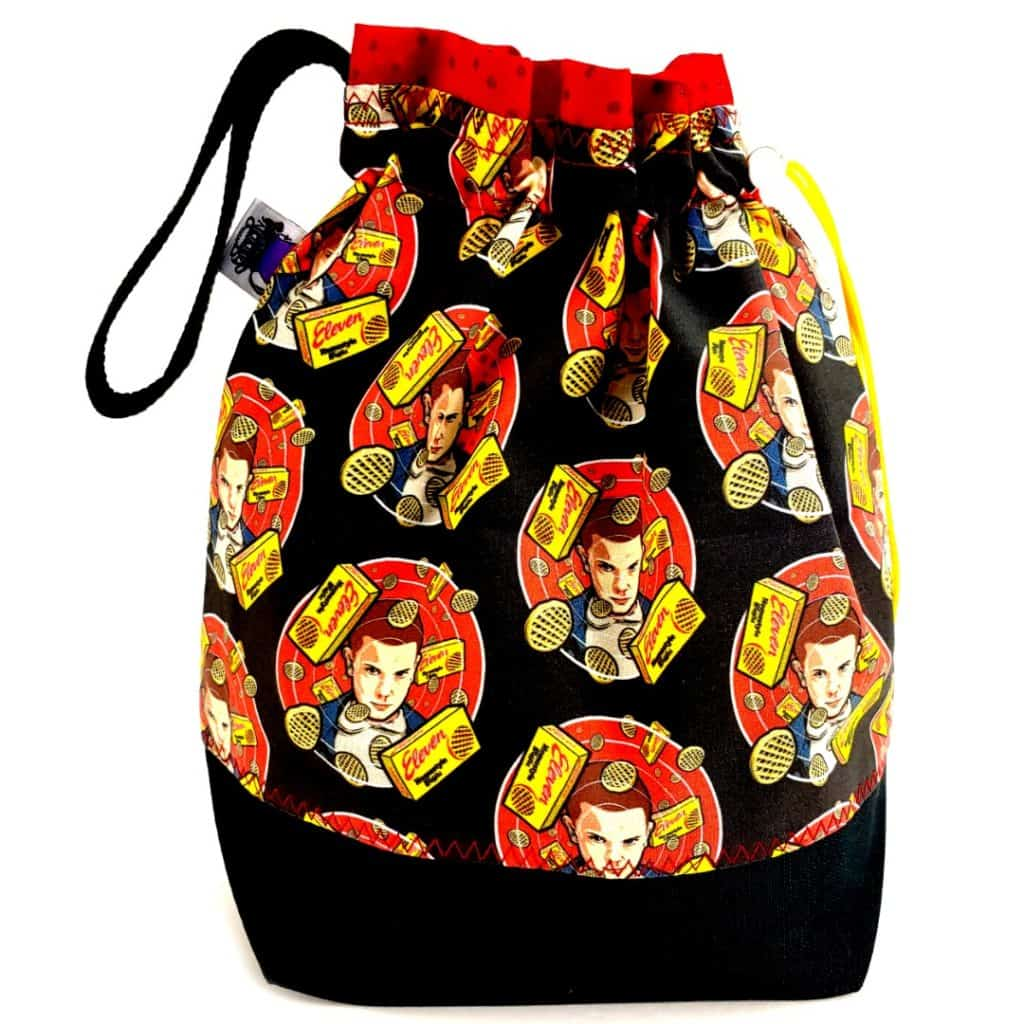 A bag with black, red and yellow Stranger Things fabric.