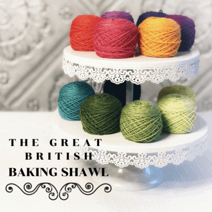 Colorful yarn cakes on a cake stand with the words The Great British Baking Shawl